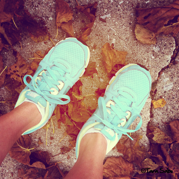nike running shoes in fall leaves